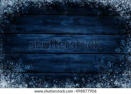 Wooden winter background. Blue horizontal boards with snow and snowflakes. Background for design #498877906