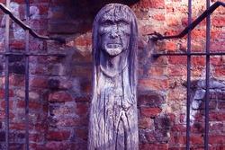 Wooden Witch Memorial Hexenbrunnen in Old roman City Augsburg in Germany