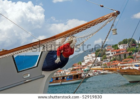 Wooden woman figure on yacht