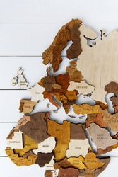 Wooden world map on a white background. Handmade. Plywood. In brown tones. The countries of Europe and South Africa. Mediterranean Sea. Top view. Tourism and travel. Woodwork.