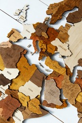 Wooden world map on a white background. Handmade. Plywood. In brown tones. The countries of Europe and South Africa. Mediterranean countries. View from above. Tourism and travel. Woodwork.
