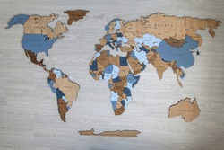 Wooden world map with continents on the wall. Geography concept. Background for travel. Logistics and transportation, worldwide business. Europe, America, Africa, Australia and Asia
