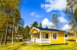 Wooden yellow house in ffinnish camp gardens