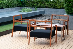 Woodend table and chairs set on wood floor, house exterior furniture