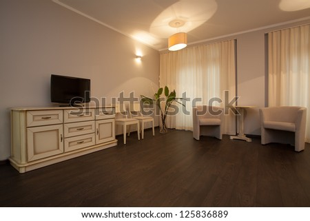 Woodland hotel - Bright hotel room with a commode - stock photo