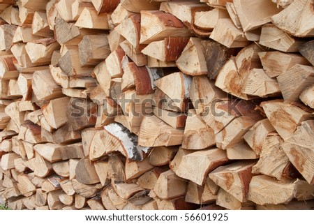 Woodpile of birch fire wood. A pile of cut wood to be used as fuel