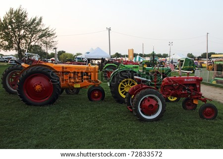 WOODSTOCK, IL - AUGUST 05: Vintage tractors at the Farmers fair and machinery exhibition on August 5, 2010 in Woodstock, IL