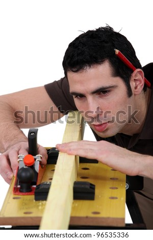 woodworker working on a board