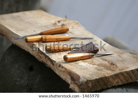 woodworkers tools, lying on a piece of woodboard, shallow DoF