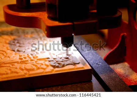 Woodworking milling machine for manufacture of engravings on wooden boards