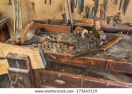 woodworking tools of antique carpentry - old bench with carpenter's ...