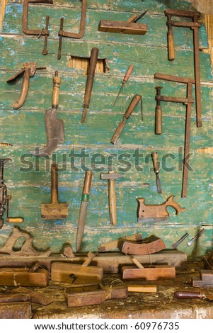 woodworking tools of antique carpentry - old bench with carpenter's equipment  - carpentry craftsman workshop
