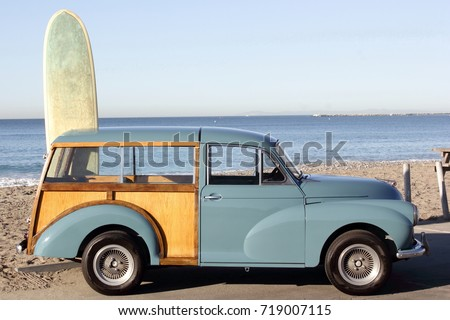 Woody at the Beach in Southern California, with leaning Surfboard