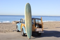 Woody at the Beach in Southern California with Surfboard