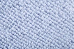 Wool blue fabric texture.Full frame details of loop pile blue carpet texture background.