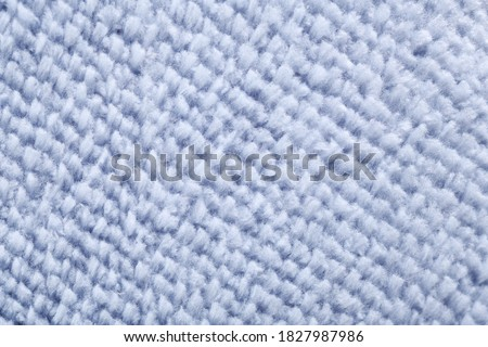 Photo of  Wool blue fabric texture.Full frame details of loop pile blue carpet texture background.