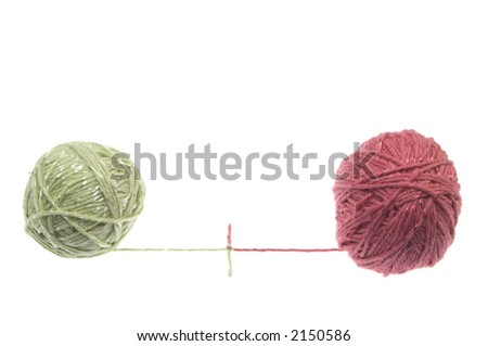 wool curled into a pink and beige balls with threads unreeled and joined together. Isolated on white background