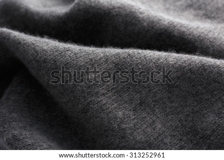 Wool fabric in grey close up texture