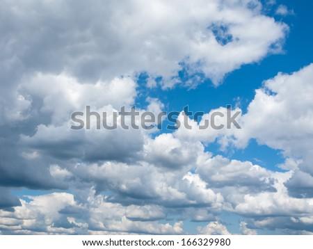 Wool-pack clouds  in blue sky  #166329980