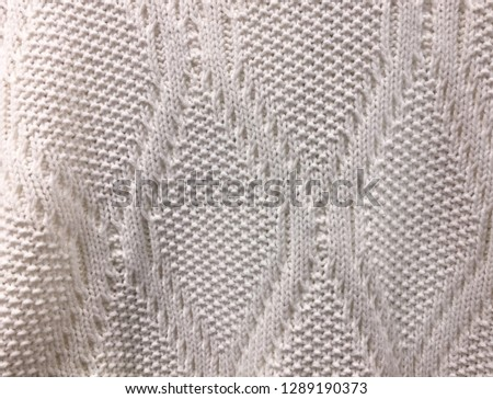 61cbcfa9bbe74 Wool sweater texture close up. Knitted jersey background with a relief  pattern  1289190373