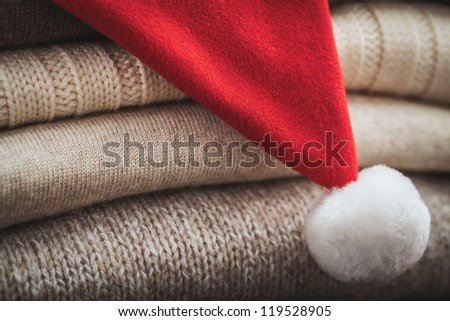 wool sweaters and Christmas hat - stock photo
