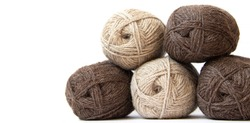 Wool yarns for knitting. Wool thread for knitting. Own hand. Knitting and needlework. Yarns for a scarf, sweater, and socks. Copy space .