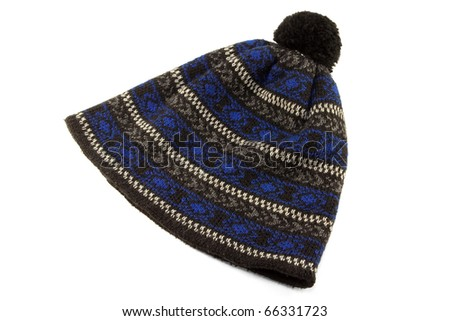 Woolen knitted cap with ornament on white background
