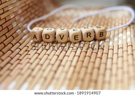 Word adverb lined with wooden cubes Photo stock ©