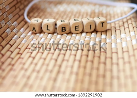 Word albeit lined with wooden cubes Stock photo ©