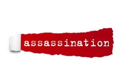 Word assassination written under the curled piece of Red torn paper. Concept Image.
