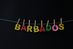 Word Barbados on black background. Barbados is an eastern Caribbean island and an independent British Commonwealth nation.