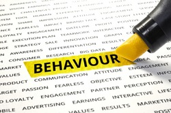 Word Behaviour highlighted with marker on paper of other related words. For direction of business marketing concept