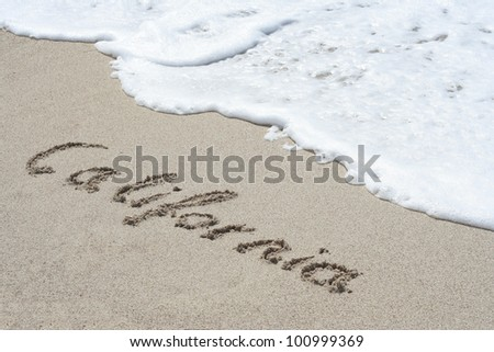 Word California on beach - vacation concept background