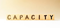 Word CAPACITY made with wood building blocks