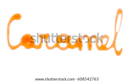 Word Caramel written with caramel sauce over white background #608542763