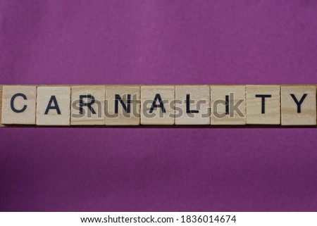 word carnality made from wooden letters lies on a lilac table Сток-фото ©