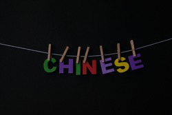 Word Chinese on black background. Chinese is the standard language of China, based on the speech of Beijing; Mandarin.