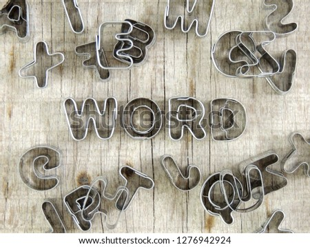 "Word concetp. Word ""word"" with metallic letters on wooden table."