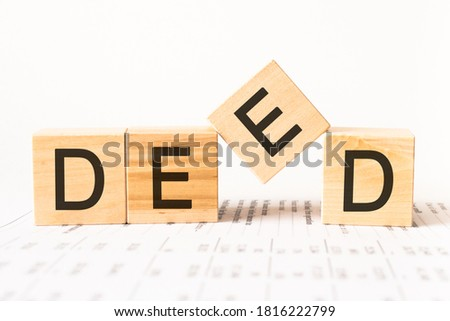Word deed. Wooden small cubes with letters isolated on white background with copy space available Foto stock ©