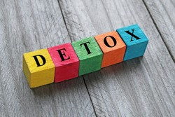 word detox on colorful wooden cubes
