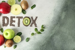Word DETOX with fresh fruits on light background