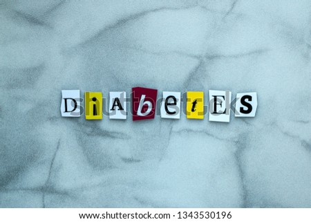 Word diabetes of cut letters on gray background for banner design. Diagnostic concept. Headline - diabetes. A word writing text - diabetes. Abstract card with an inscription - diabetes  #1343530196