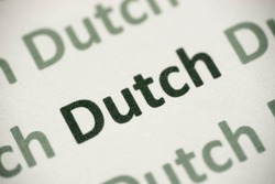 word Dutch language printed on white paper macro
