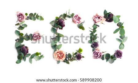 Word Eco made of leaves and flowers on white background. Nature photo inscription