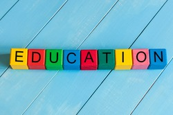 Word Education on children's colourful cubes or blocks - educational background for teaching