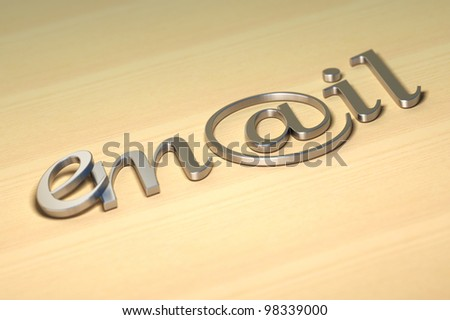 word email written with steel letters onto a wooden background with blur effect