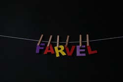 Word Farvel on black background. Farvel means good bye in Danish . Concept for art, learning, and education.