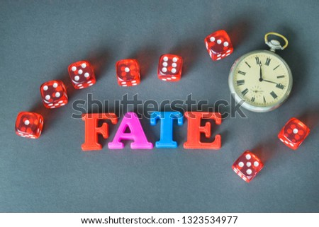 Word Fate made of colorful letters and retro watch on the dark background.  #1323534977