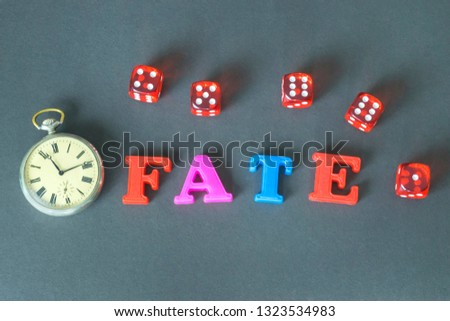 Word Fate made of colorful letters and retro watch on the dark background.  #1323534983