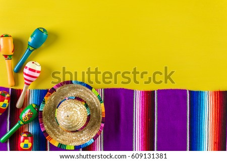 Word Fiesta on a bright painted wood background. #609131381